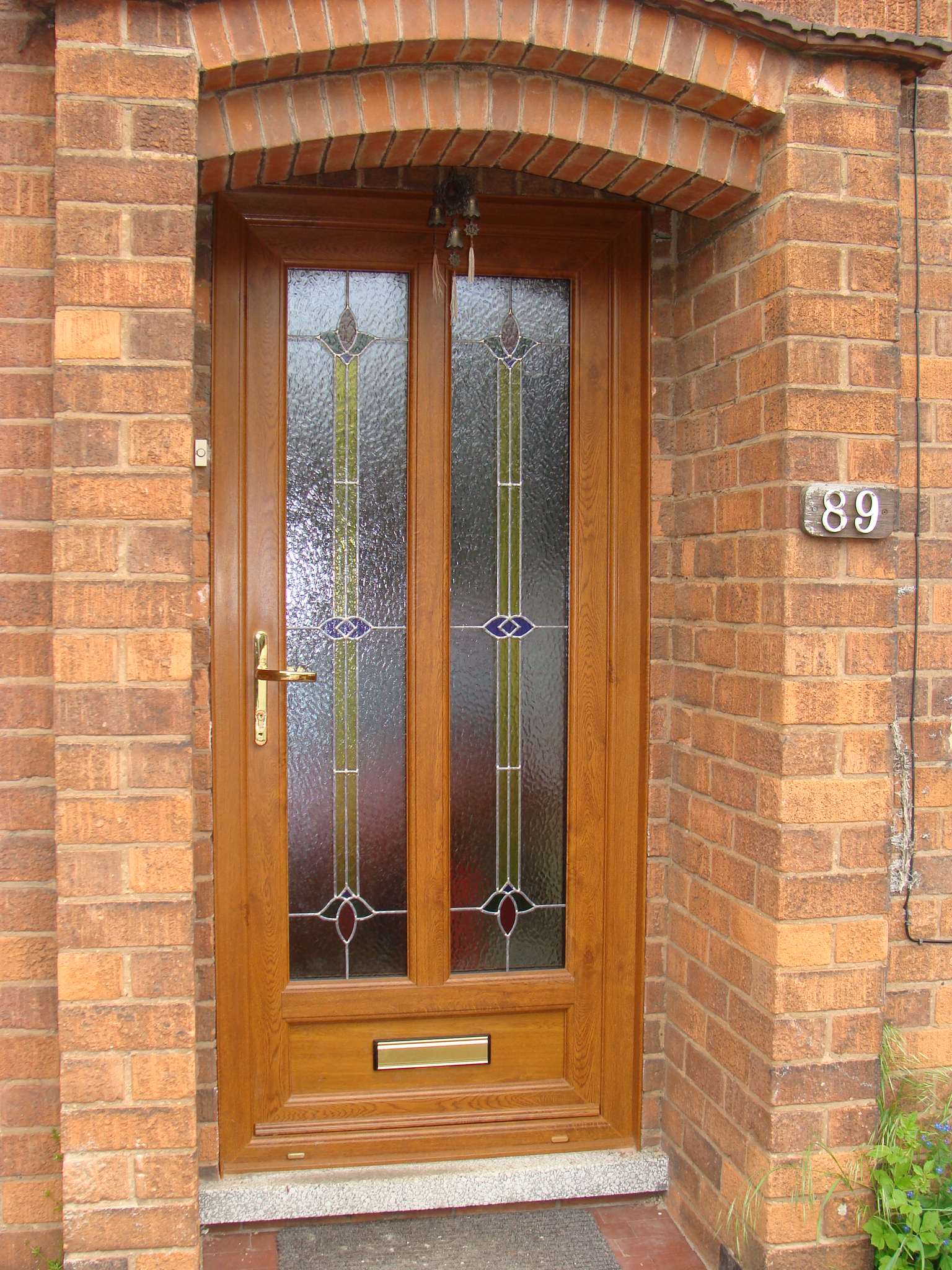 Upvc golden oak coloured lead dm windows for Coloured upvc doors